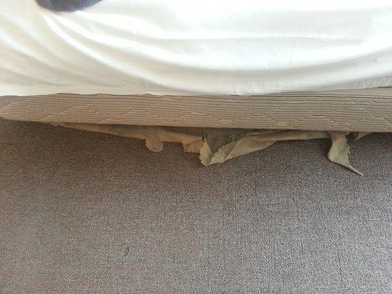 The Krystal Suites: torn bed lining