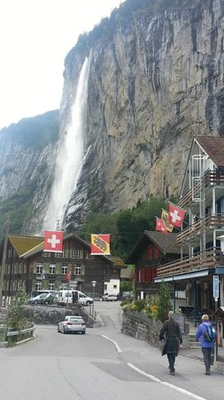 Hotel Jungfrau Lauterbrunnen: Near Staubbach Falls - hotel is on right side of pic with flags