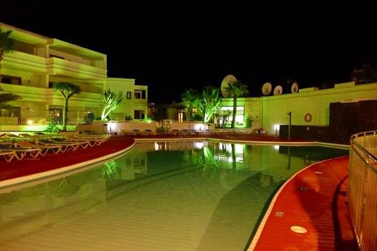 Oceano Apartments: The pool at night.