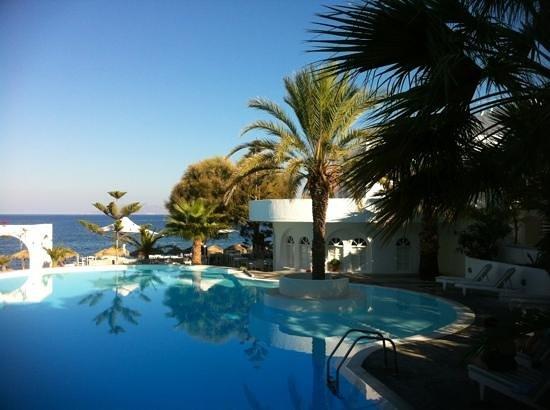 Thalassa Sea Side Resort & Suites: the pool and pebble beach