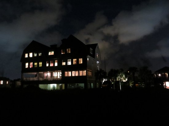 Elizabeth Pointe Lodge: The main building at night from the beach.