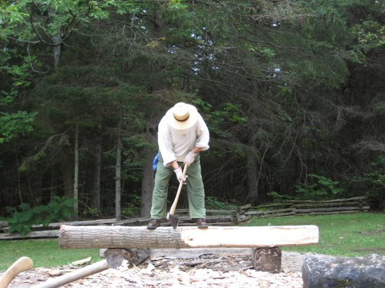 Historic Mill Creek Discovery Park: Prepping the log by clearing off the bark