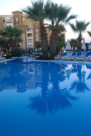 IBEROSTAR Isla Canela Hotel: Reflections on the pool