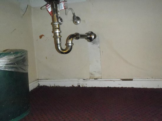 Country Hearth Inn: Water damage under the sink.