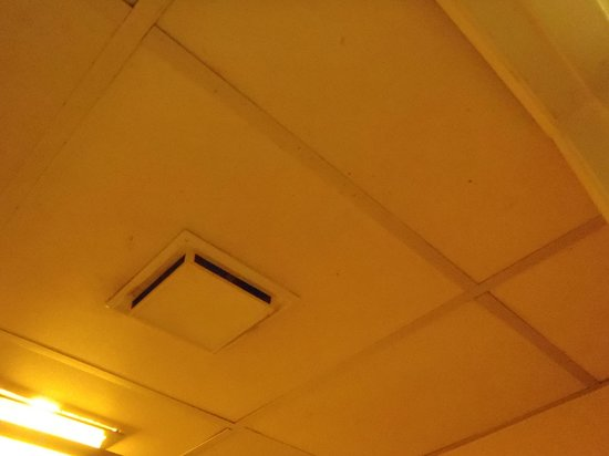 Country Hearth Inn : Drop ceiling with moldy fan