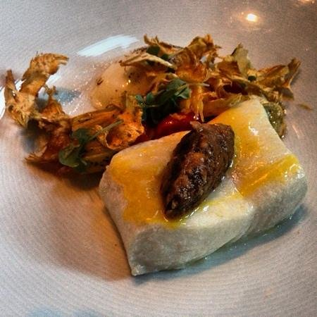 RN74: poached halibut with artichoke hearts, eggplant, and poached egg