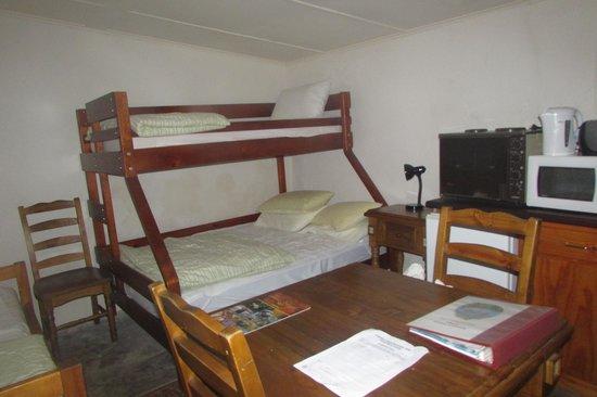 Rocky River Heritage Accommodation: Inside Postmans Cottage