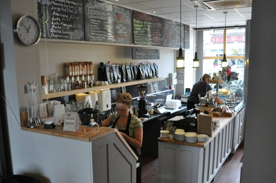 About Coffee Ltd: The counter in About Coffee, Colne, packed full of coffee and cake!