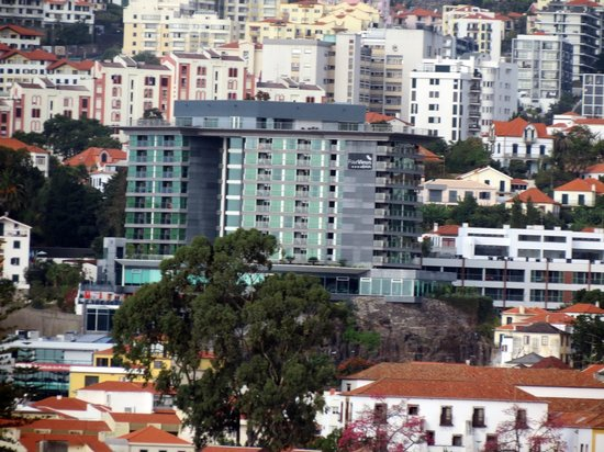 Four Views Baia: Hotel from tha cablecar of Funchal