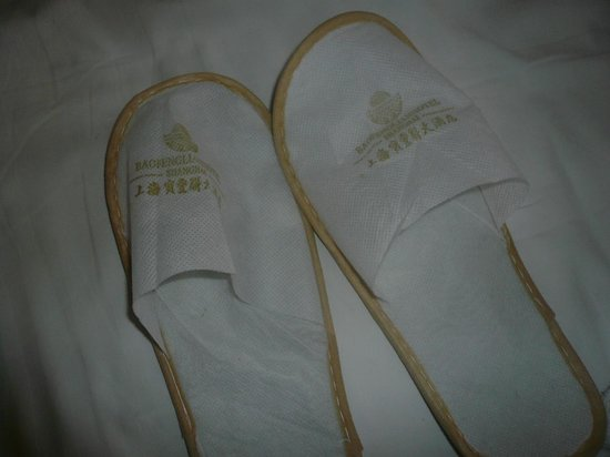 Bothland Hotel Shanghai: Lovely that they gave free slippers, but literally paper thin