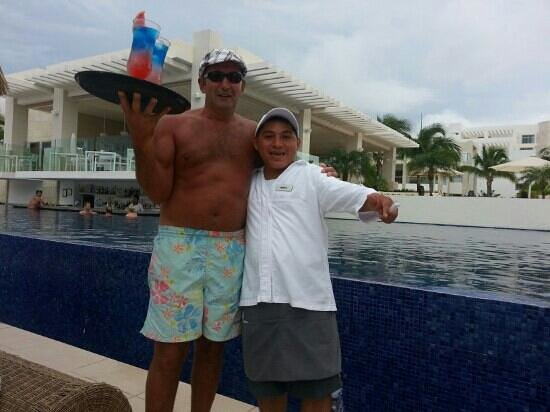 Beloved Playa Mujeres: manilo one of many of the wonderfull staff that served u on the beach and pool