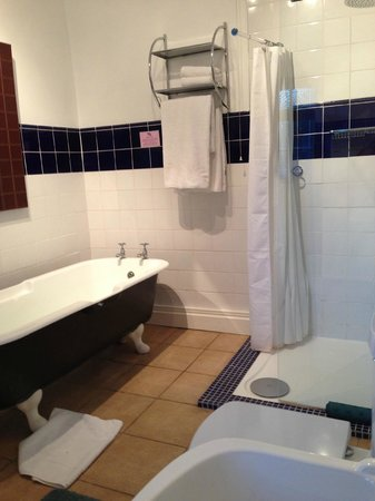 Satis House Hotel : Walberswick room - antique roll top bath in an traditional bathroom