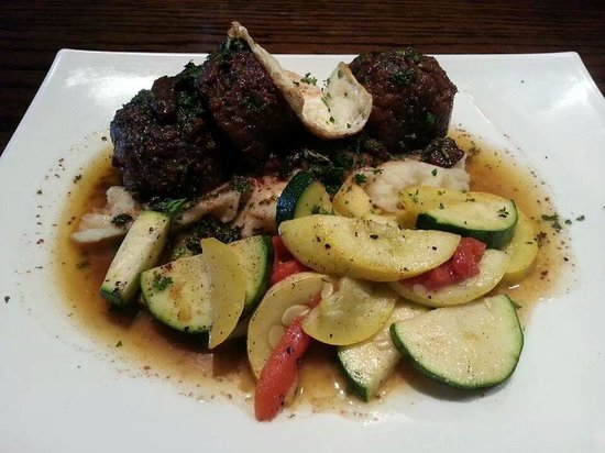 Groovy Grouper Grill: a great meatloaf with Merlot sauce, fresh veggies, mashed potatoes and fried egg