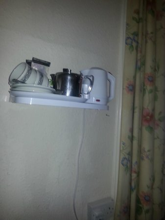 """Lomond Hills Hotel: coffee & tea at side of bed approx 6"""" from bed side."""
