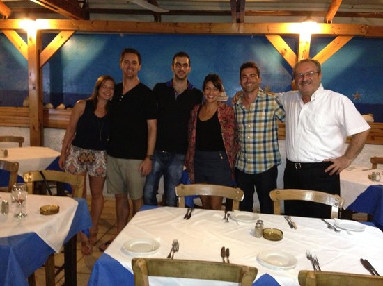 Vachus Taverna: Our group with Dimitri and his son