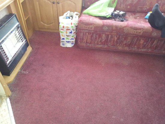 Sandaway Beach Holiday Park : Silver Caravan Living room Carpet, threadbare and stinking