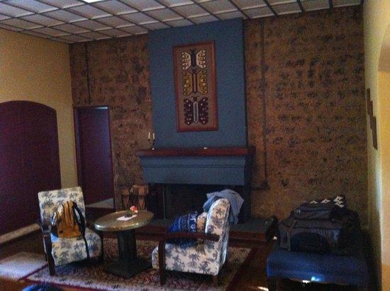 Hacienda La Cienega: Fireplace in bedroom