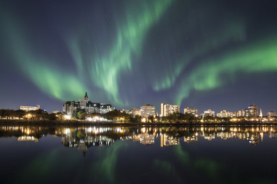 Saskatoon's riverbank with the Northern Lights at the backdrop