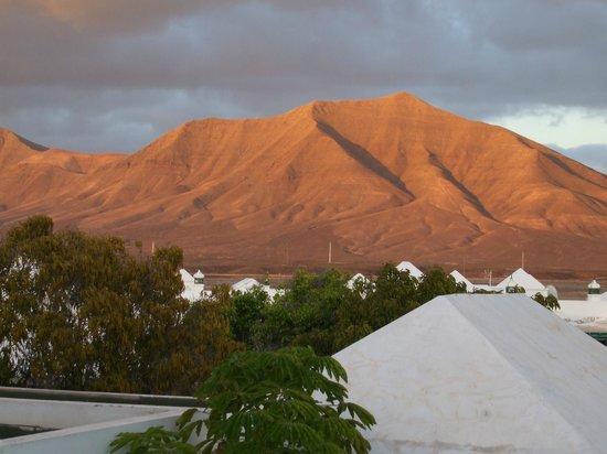 THB Royal: Mountains at sunset