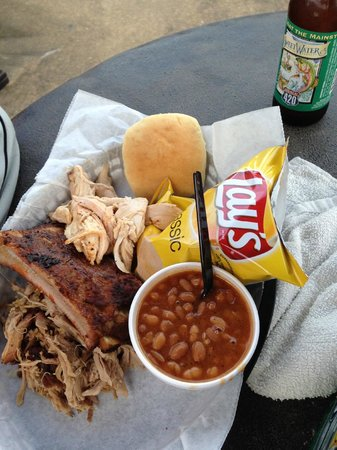 Joe's BBQ: The Sampler - with baked beans, chips and a beer.