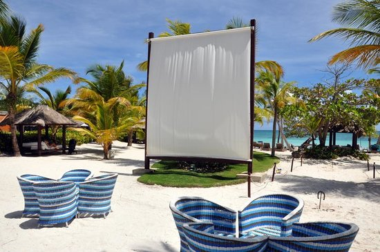 Sanctuary Cap Cana by Playa Hotels & Resorts: The projector screen for nightly football