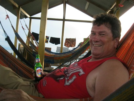 TioTomsGuesthouse: sitting in the hammock area enjoing a beer and the fantastic sea view