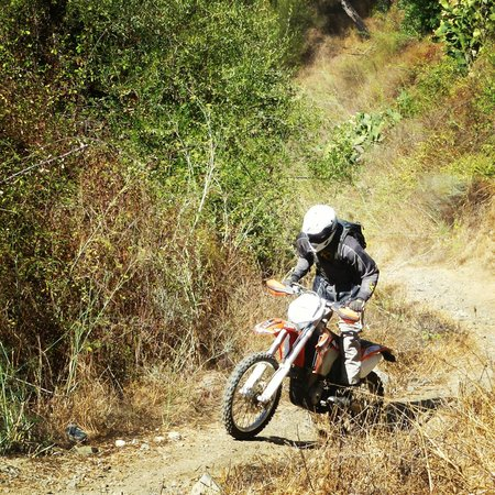 Riders of the Lost Trail - Guided Off Road Motorcycle Trail Tours : Wrestling the motor