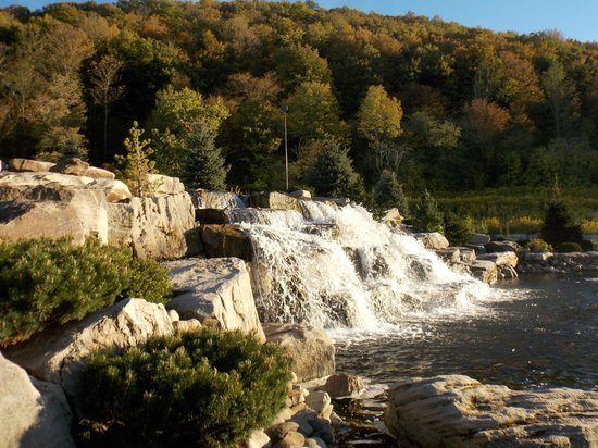 Seneca Allegany Resort & Casino : Waterfall at entrance with Allegany Mountains in background.