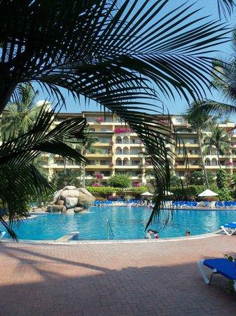 Velas Vallarta: Tropical plants surround the pool