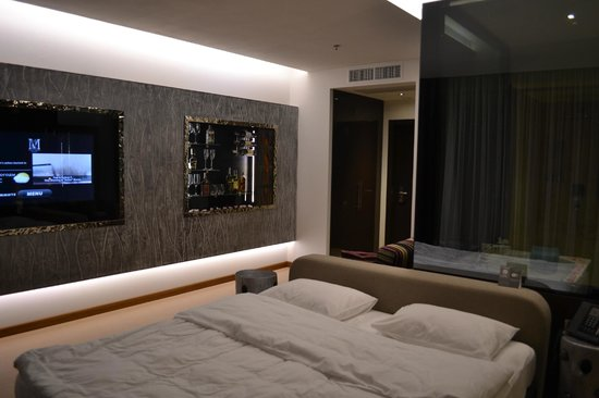 Room with turn on tv picture of 11 mirrors design hotel for Design hotel kiev