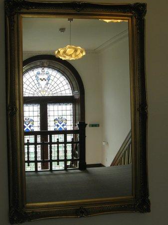 Greystones: upper hall reflected in mirror