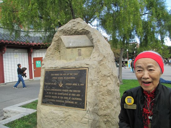 Wok Wiz Chinatown Tours : Our tour guide, Dorothy, at the stature commemorating the 1st public school.