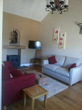 Apple Tree Cottages: roomy living room and log fire