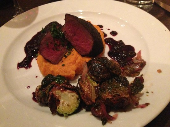 Local Restaurant & Bar : Elk medalions with sweet potatoes  and huckleberry sauce with a few brussel sprouts