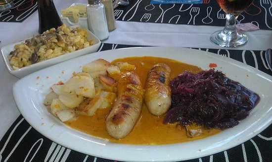 Austrian-German Restaurant: Currywurst with roasted potatoes, red cabbage, and spaetzle.