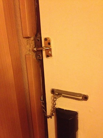 Sheraton Abuja Hotel: Door lock missing, chain is set so you can't see who is at the door, peephole stopped up with gu