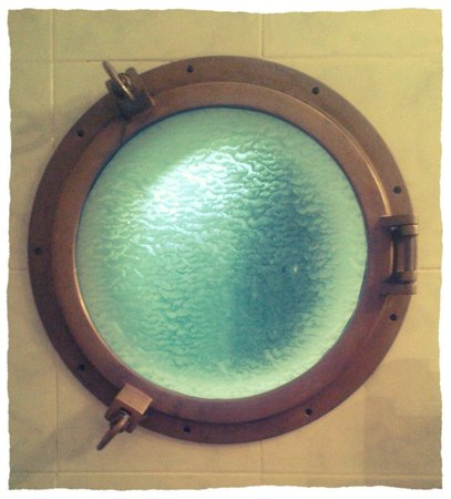 Metropole: The pretty porthole onto balcony in the Junior Suite (#183) on the top floor!