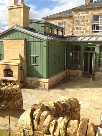Links House at Royal Dornoch: The rear entrance and outdoor fire place