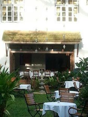 Garden and restaurant dining  - Old Harbour Hotel