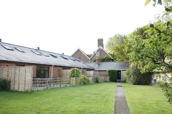 The Old Stables: The gardens with individual patio areas