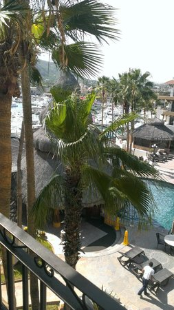 Marina Fiesta Resort & Spa: View of the pool, La Palapa, and the marina from our balcony