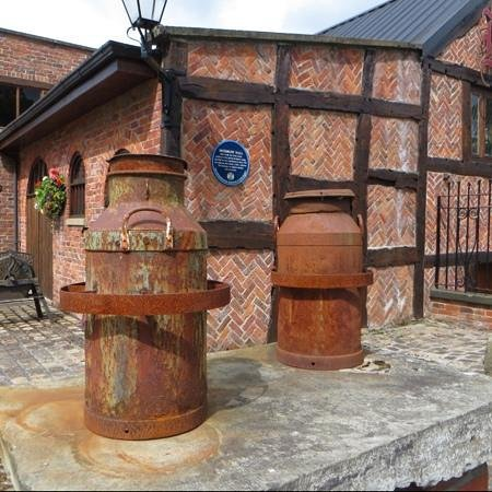 Bredbury Hall Hotel: old milk urns
