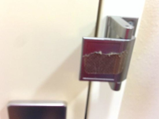 Homewood Suites by Hilton Cedar Rapids North : Used bandaid on door lock.