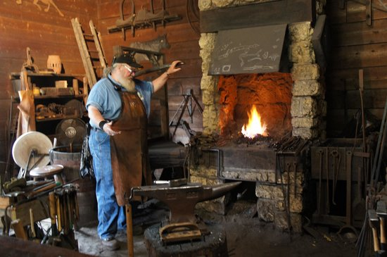 The blacksmith at his forge - Picture of John Deere Historic
