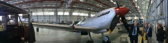 Battle of Britain Memorial Flight Visitor Centre : Looking at a Spitfire with our guide