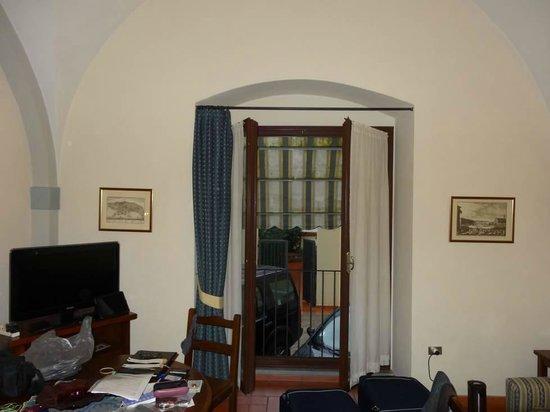 Residence La Contessina: Living area showing patio window/ door