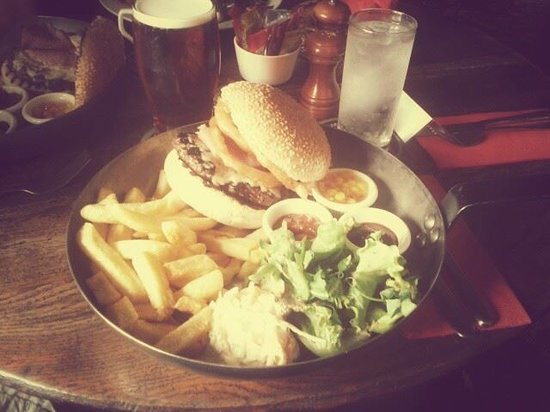 Druid Inn Birchover : A Druid Burger! Chargrilled sesame seed bun, beef burger, bacon, Cheddar cheese and onion rings!