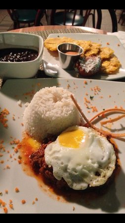 "Yerba Buena Restaurant: Picadillo with rice, beans, tostones, and cod fritters ""a caballo"" (with egg on top). YUMMY!!"