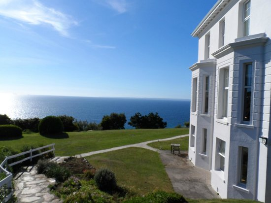 Polurrian Bay Hotel: A view of a small part of the garden and the view from those gardens.