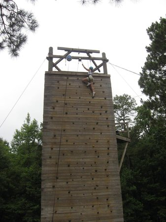 Troy, AL: Janet Kynard rings the bell on the Climbing Wall at Camp Butter and Egg